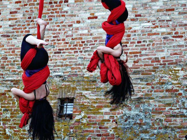 Streetphotography Street Artist Abstract Streetart Women Red Red Color Long Hair Acrobats Eyemphotography Langhe Nice Day