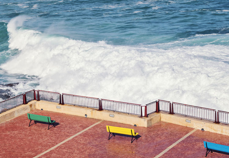 Empty benches on the strand during a storm Bench Coastline Malta Nature Promenade Storm Stormy Weather Strand Day Elementary Age Empty Foam High Angle View Low Season Minimalism Nature No People Ocean Outdoors Sea Splashes Street Water Waves Yellow EyeEmNewHere The Graphic City