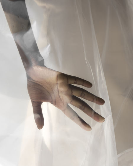 Cropped hand of bride touching veil