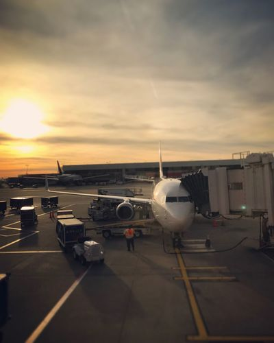 Airplane Transportation Airport Sky Airport Runway Travel Mode Of Transport Air Vehicle Passenger Boarding Bridge Commercial Airplane Sunset Runway Cloud - Sky Day Airplane Wing Real People Real Life Traveling Airportphotography Luggage Cart  Luggage Trolleys Let's Go. Together. Investing In Quality Of Life