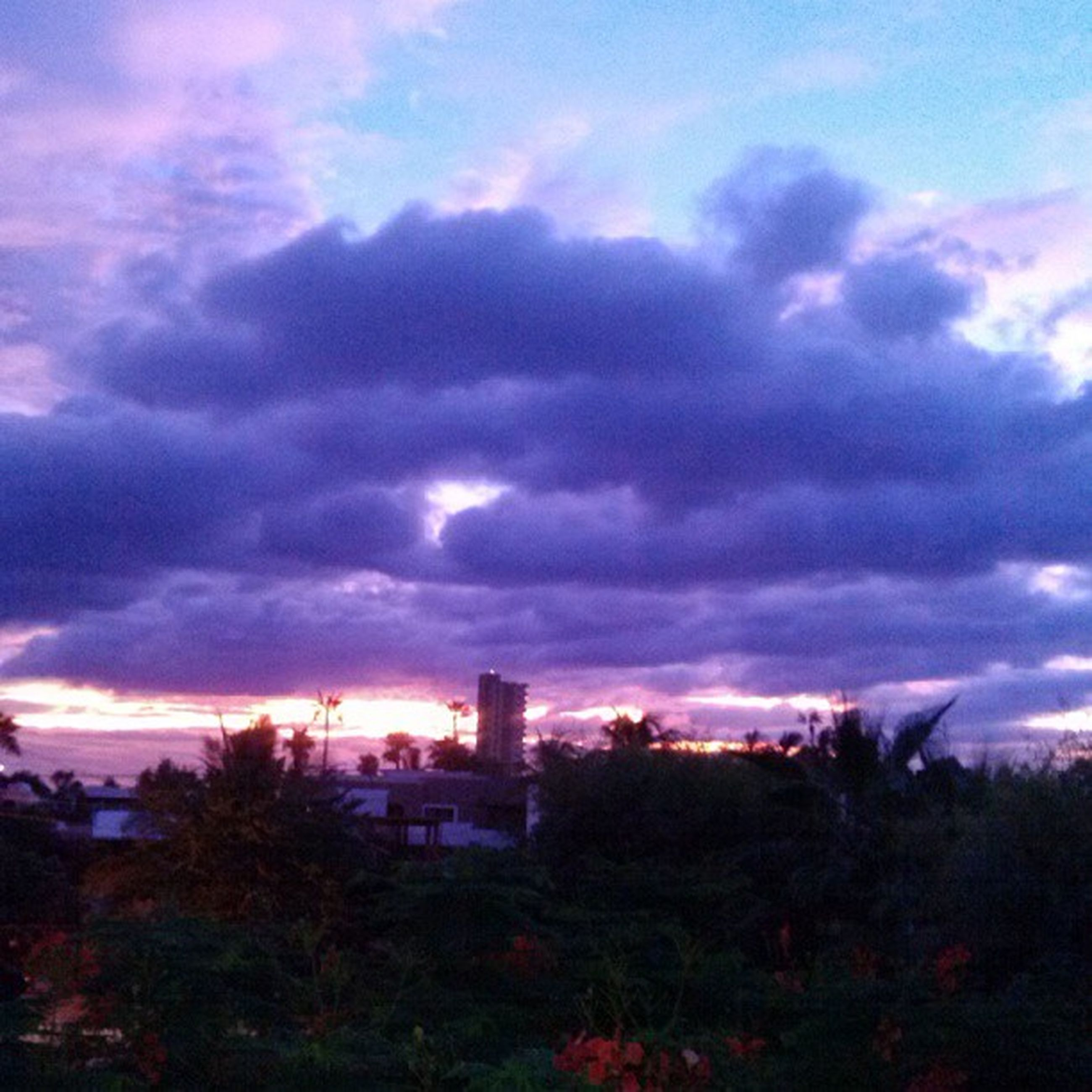 sky, cloud - sky, building exterior, architecture, built structure, sunset, tree, cloudy, beauty in nature, house, nature, cloud, growth, dramatic sky, scenics, weather, tranquility, dusk, landscape, field