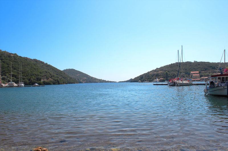 Inviting waters Bay Clear Sky Greece Harbor Lefkas Outdoors Sea Shore Tranquil Scene Waterfront