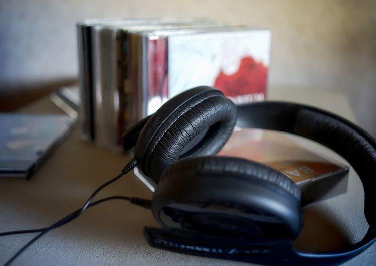 High angle view of headphones and compact discs on table