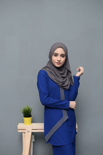 Beautiful young Muslim Girl wearing traditional blue dress with Hijab.Hijab fashion for eid mubarak. Eid Mubarak Fashion Hari Raya Aidilfitri Muslimah Eid Fashion Photography Girl Hijab Hijabbeauty Hijabfashion Hijabstyle  Muslim Muslimahfashion