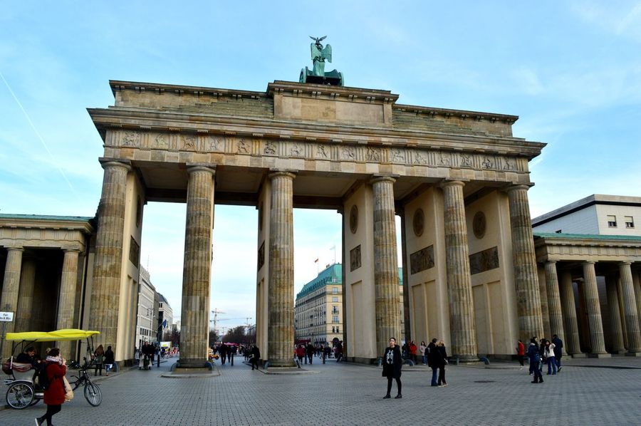 Architectural Column Architecture Building Exterior Built Structure City City Gate Day History Large Group Of People Outdoors People Real People Sculpture Sky Statue Tourism Tourist Travel Travel Destinations Vacations