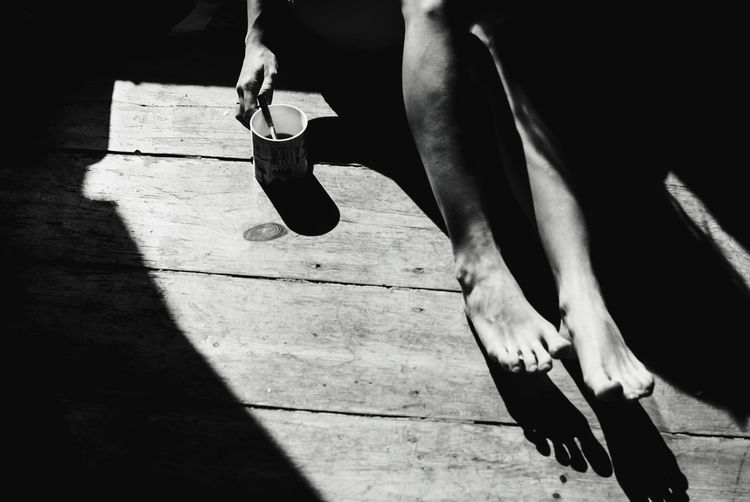 Foot Bw Bw_collection Coffee Coffee - Drink Light Lifestyles Body Part Footsteps person Human Home Room EyeEmNewHere Low Section Men Talcum Powder Shadow Flexibility Sportsman Athlete Sport Human Leg Healthy Lifestyle Sports Shoe Shoelace Tying Shoe Footwear Human Foot