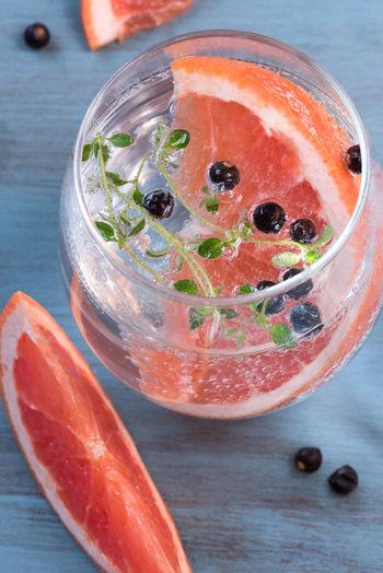 Grapefruit Juniper Berry Gin and Tonic Adult Alcohol Berries Beverage Cheers Citrus  Close-up Cocktail Drink Drinking Glass Grapefruit Juniper Libation