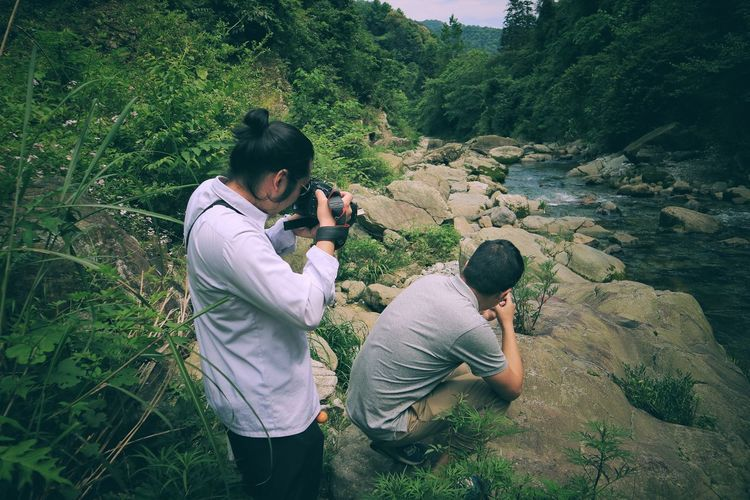 The Great Outdoors - 2017 EyeEm Awards Real People Photographing High Angle View Outdoors Men Two People Lifestyles Photography Themes Camera - Photographic Equipment Growth Nature People Adult Day Leisure Activity Togetherness Young Adult Adults Only Live For The Story The Week On EyeEm