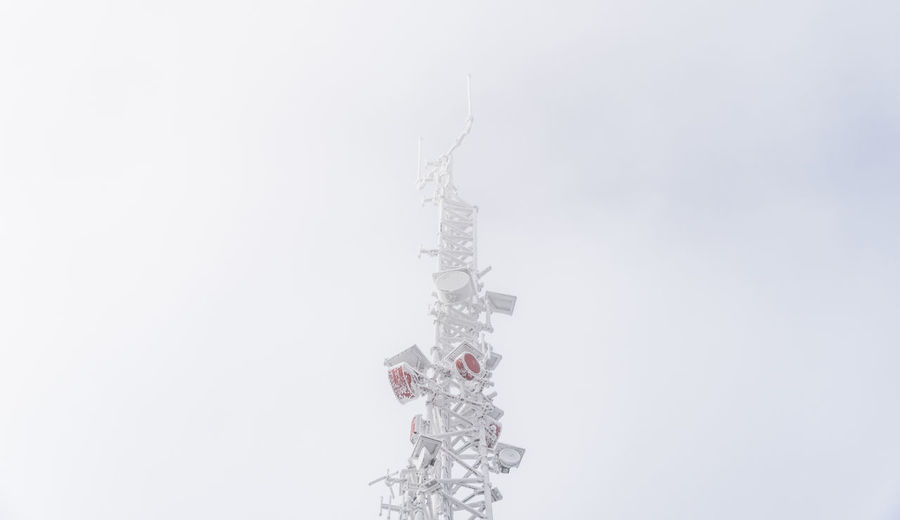 Close-up of frozen tower against sky