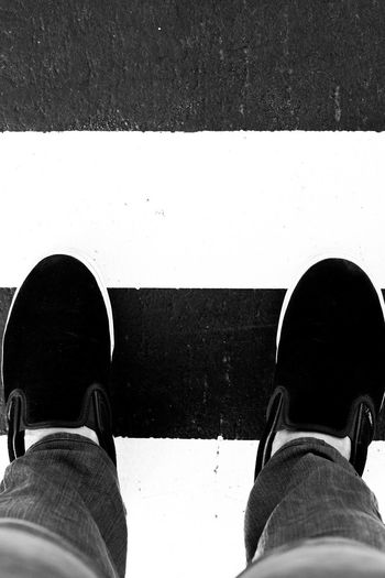 Black and White Low Section Shoe Person Personal Perspective Standing Road Men High Angle View Street Leisure Activity Footwear Lifestyles Directly Above Road Marking Transportation Human Foot Human Limb Overhead View Sewer Gutter Exploring Throughthelens EyeEm Gallery Eyeem Philippines