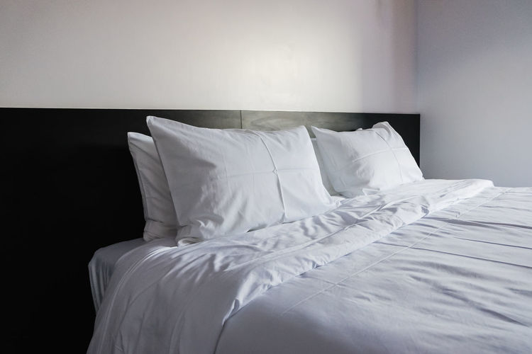 White Blanket On Bed At Home