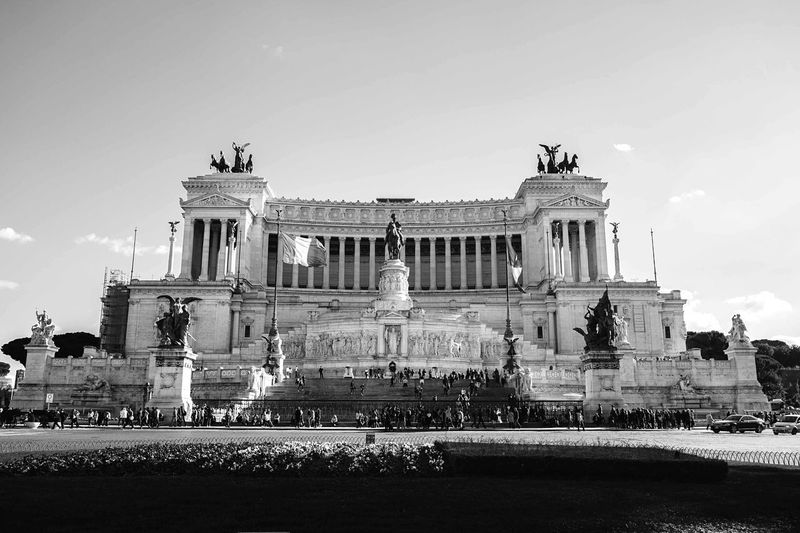 Architecture Statue Travel Destinations Built Structure Architectural Column Large Group Of People Building Exterior Illuminated Low Angle View Sculpture Outdoors City Real People Tourism Day History People Travel Sky
