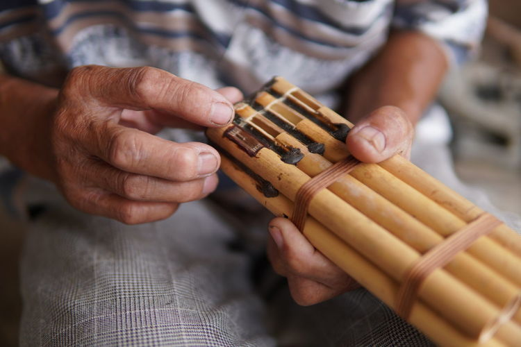 sumpotan, a mouth organ made from gourd with bamboo pipes in the northern borneo, sabah, malaysia.