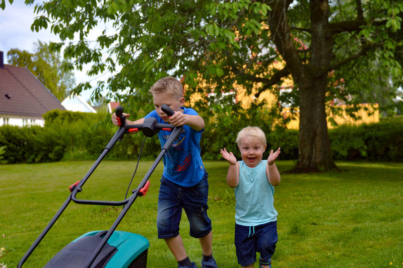 """""""This is sooooo fun..."""" EyeEm Portraits EyeEm Gallery The Week On EyeEm Baby Blond Hair Bonding Boys Brothers Childhood Day Eye4photography  Full Length Grass Holding Males  My Heart ❤ Outdoors People Playing Portrait Son Standing Togetherness Tree The Portraitist - 2018 EyeEm Awards"""