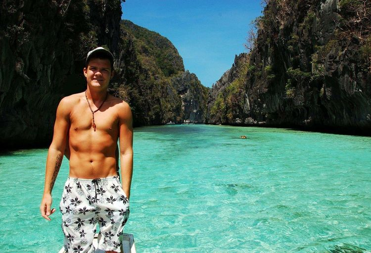 Portrait Of Shirtless Young Man Standing In Sea