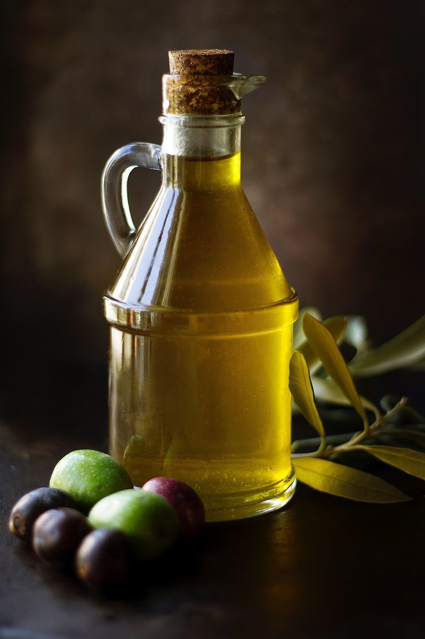 Close-Up Of Olive Oil Bottle On Table