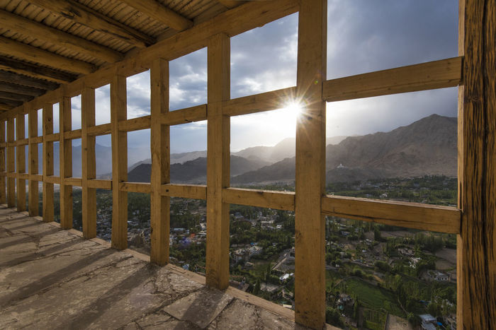 Sun shining through wooden structure