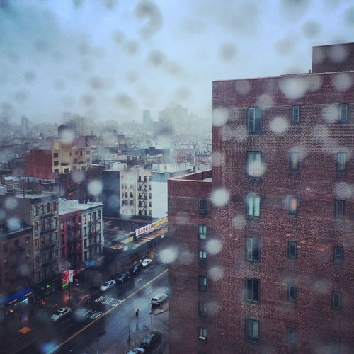 Rainy Day in NYC Architecture Building Building Exterior City City Life Community Development Human Settlement Rain Residential District Residential Structure Street
