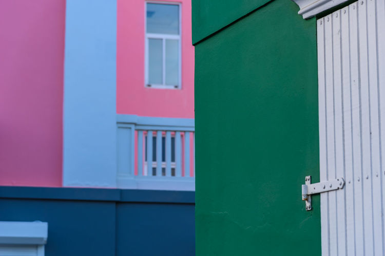 ABC Travel Architecture Blue Building Building Exterior Built Structure Caribben City Day Door Entrance Green Color House Island Multi Colored Nature No People Outdoors Pink Color Red Residential District Turquoise Colored Wall - Building Feature Window