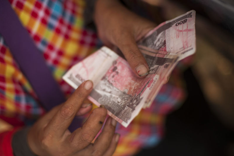 Close-up of hand holding paper currency