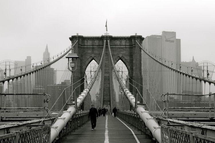 People On Brooklyn Bridge In City