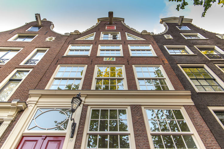 Amsterdam Netherlands Architecture Building Building Exterior Built Structure Canal Houses City Cloud - Sky Day Dutch Houses Glass - Material History Holland Low Angle View Nature No People Outdoors Plant Reflection Residential District Sky Sunlight The Past Tourist Destination Window