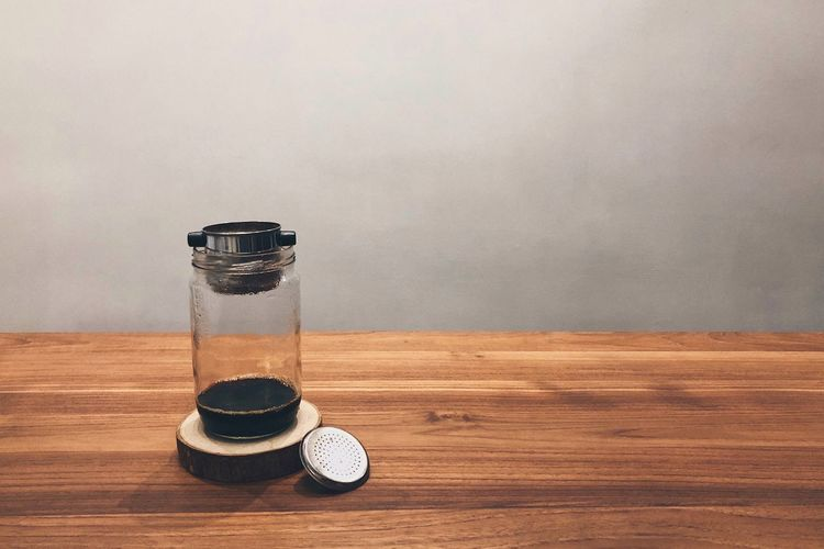Wood Black Coffee Drip Coffee Coffee - Drink Coffee Indoors  Table Wood - Material No People Copy Space Still Life Arts Culture And Entertainment Technology Wall - Building Feature Single Object Retro Styled Creativity Brown Lighting Equipment Close-up Nature Container Flooring Pattern