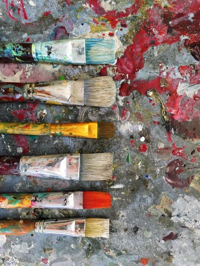 Brushes coverd with paint No People Indoors  Day Close-up Architecture Brushes Work Tool Colorful Backgrounds Art Indoors  Oil Paint Multi Colored Palette Wood - Material Paint Paintbrush Choice