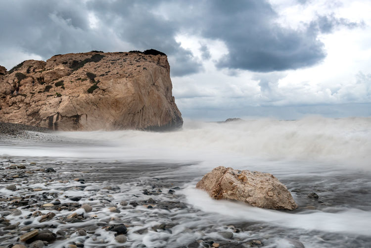 Seascape during stormy weather at the rocky coastal area of the rock of aphrodite in paphos cyprus.