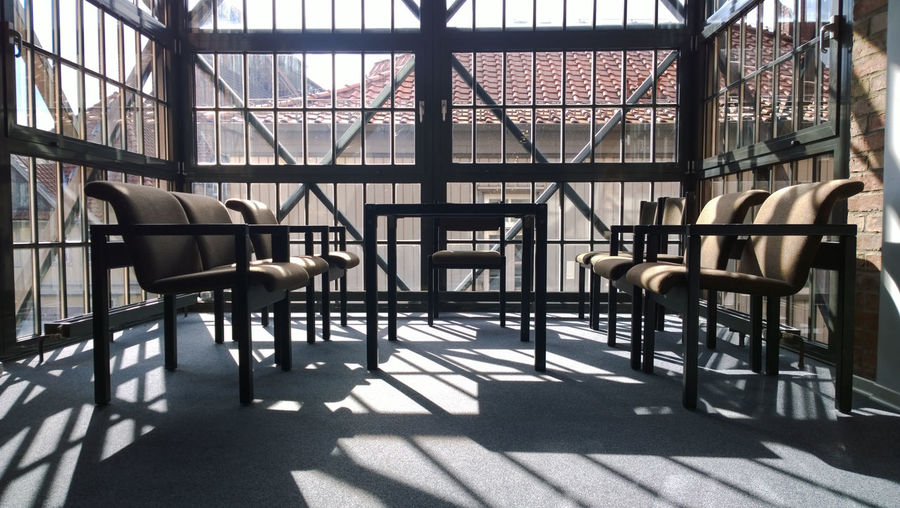 Absence Brick Wall Bundesakademie Für Kulturelle Bildung Chair Chairs Contemporary Design Empty Flooring Germany Glass Glass - Material In A Row Indoors  Light And Shadow Metal Narrow Repetition Seat Shadow Table Wall Window Wolfenbüttel