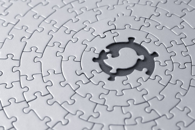 grey jigsaw with space and one of the missing pieces in the center - pieces fitting together in form of a spiral Business Choice Textured  Textures And Surfaces Background Backgrounds Business Finance And Industry Challenge Close-up Concept Conceptual Connection Education Full Frame Grey Jigsaw Piece Jigsaw Puzzle Large Group Of Objects Pattern Puzzle  Standing Out From The Crowd Strategy Teamwork Togetherness Wallpaper