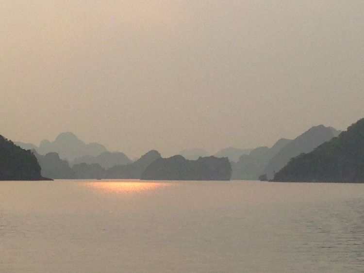 Sunrise on the sea Halong Bay Vietnam Light Reflection Beauty In Nature Copy Space Fog Idyllic Landscape Mountain Mountain Range Nature No People Non-urban Scene Outdoors Scenics - Nature Sea Sky Sunrise Tranquil Scene Tranquility Water Waterfront