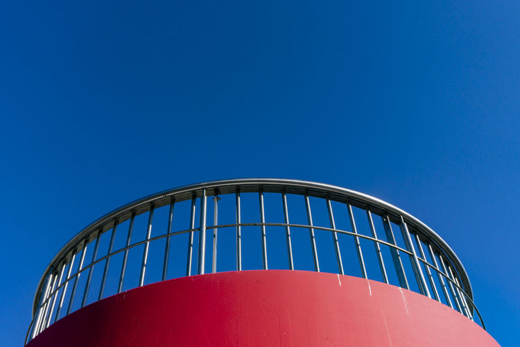 Berlin, Germany, October 13, 2018: Low Angle View of Railing of Red Viewing Stand Against Blue Sky Berlin Germany 🇩🇪 Deutschland Color Image Horizontal Outdoors No People Blue Low Angle View Sky Clear Sky Copy Space Architecture Built Structure Red Security Railing Viewing Platform Clear Sky Backgrounds Copy Space Round Shape Metal Absence Pattern Repetition