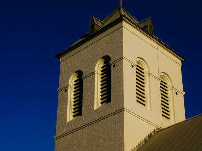 Architecture Bell Tower Blue Building Exterior Built Structure Clear Sky Day Low Angle View No People Outdoors Sky Window Church Roof Shutters High Sky Blue Exposure