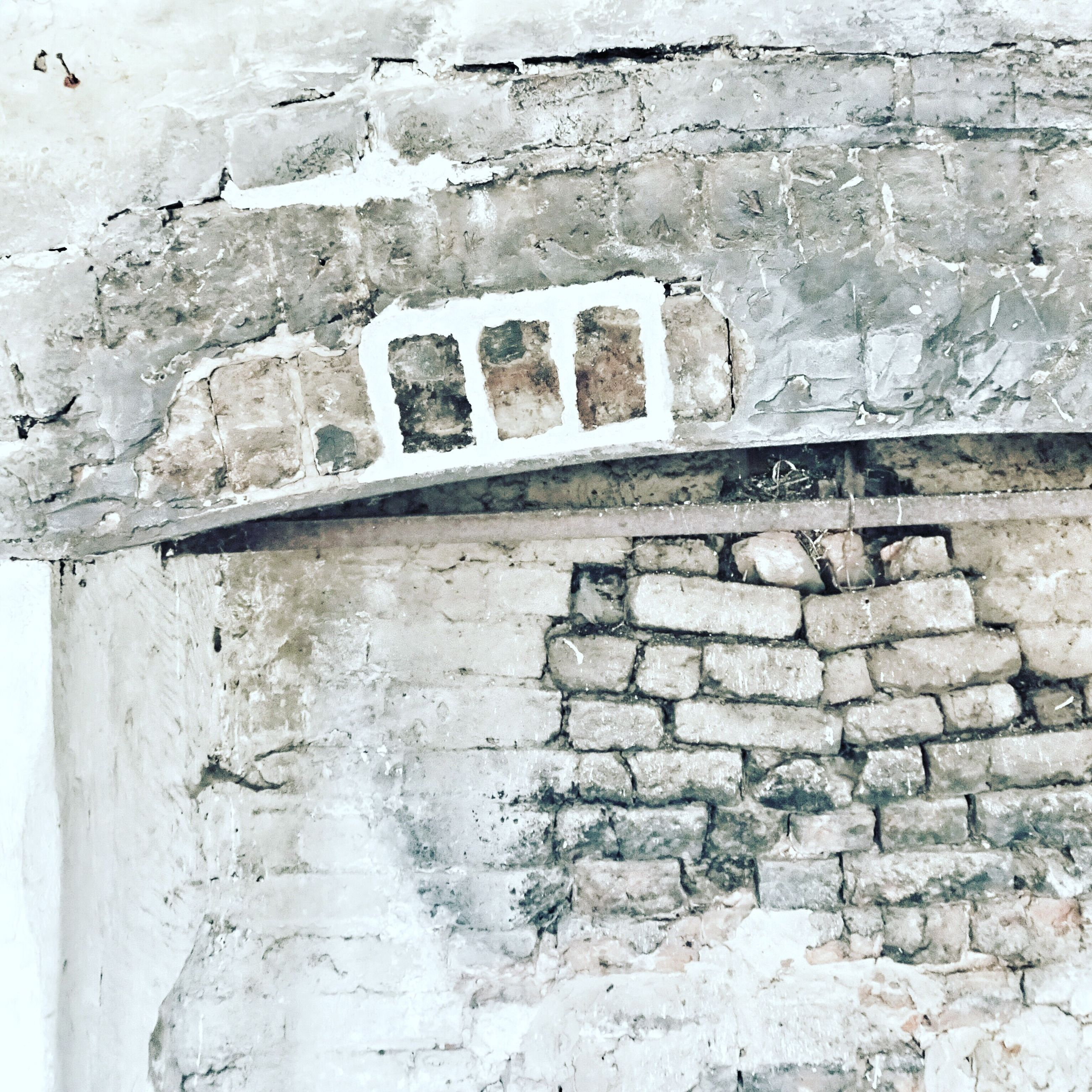 architecture, built structure, wall - building feature, building exterior, stone wall, brick wall, wall, old, weathered, history, text, day, textured, outdoors, stone material, the past, brick, western script, ancient, no people