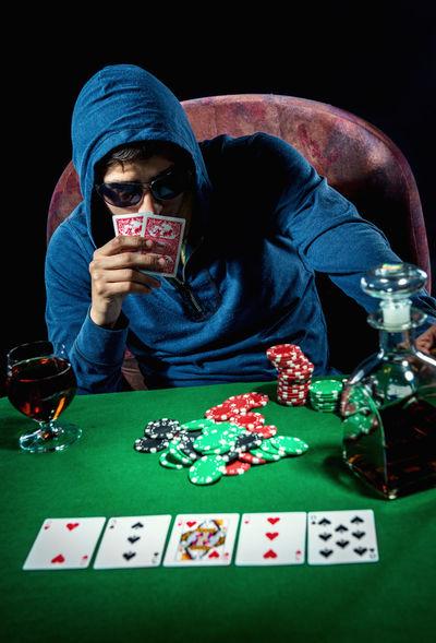 Poker player. Gambling concept Blackjack Casino Gambling Jackpot Man Poker Addiction Casino Entertainment Gambler Gambling Gambling Chip Game Leisure Games Male One Person Player Playing Playing Card Games Poker - Card Game Poker Chips Poker Game Studio Shot Table Young Adult
