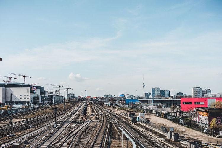 Railway tracks against sky in city
