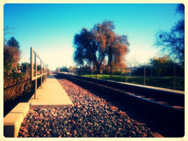 Walking together along this railway which life is. Poetry is around us, sometimes merry sometimes gloomy. Mobilephotography Xperiagraphy Railways No People Lumiocam Pixlr Visual Poetry Outdoors Country Life Vanishing Point