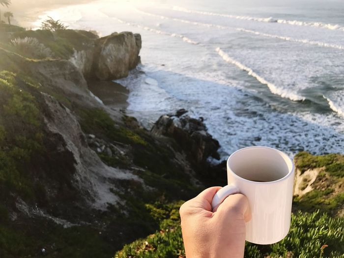 Good morning. // Holding One Person Coffee Cup Coffee - Drink Human Hand Human Body Part Refreshment Drink People Adults Only Leisure Activity Real People Mug Outdoors Nature Day One Woman Only Close-up Adult Only Women