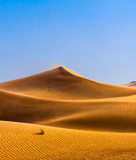 desert dunes Sand Dune Clear Sky Mountain Desert Arid Climate Sand Accidents And Disasters Sunlight Heat - Temperature Environment