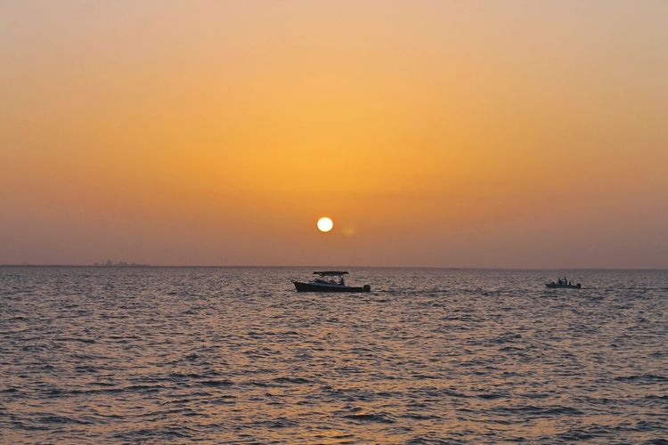 Alabamasunset Sunset Sea Horizon Over Water Beauty In Nature Scenics Nature Water Orange Color Sky Sun Clear Sky Boat Boats⛵️ Sunset_collection Tranquility Tranquil Scene Transportation Idyllic Nautical Vessel Mode Of Transport Outdoors Waterfront No People