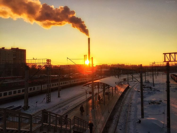 Sunset 🌅 Industry Factory Sunset Smoke Stack Built Structure Fuel And Power Generation Outdoors Sky Nature Air Pollution No People Architecture Water Day Beauty In Nature City Cityscape Architecture Building Exterior Nature Weather Cold Temperature Winter Dramatic Sky Orange Color The Architect - 2017 EyeEm Awards The Street Photographer - 2017 EyeEm Awards Shades Of Winter