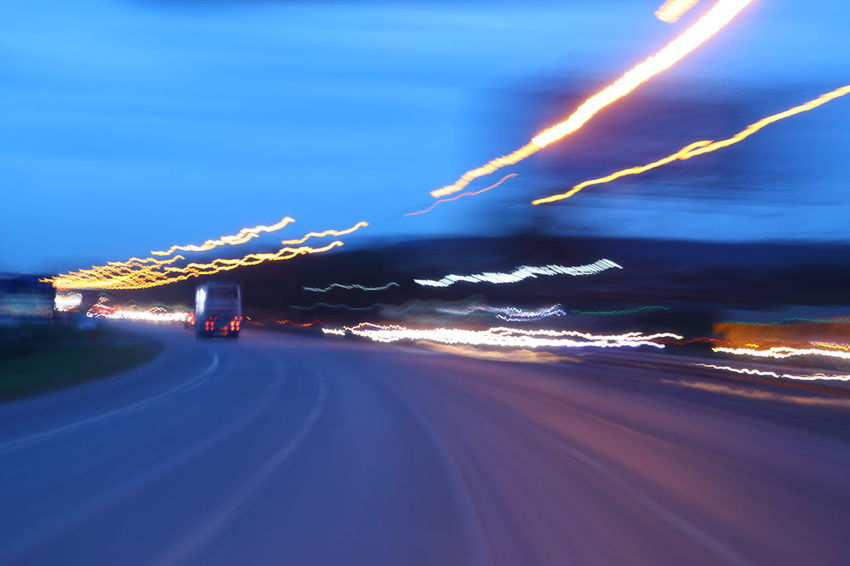 Blurred Motion City Cloud - Sky Illuminated Light Light Trail Lighting Equipment Long Exposure Motion Motor Vehicle Nature Night No People on the move Outdoors Power In Nature Road Sign Sky Speed Street Transportation