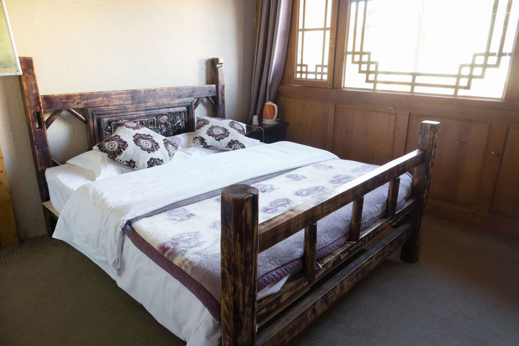 Bed Chinese style Furniture Indoors  No People Domestic Room Home Interior Architecture Window Absence Bed Seat Table Wood - Material House Bedroom Pillow Day Home Home Showcase Interior Animal Flooring China