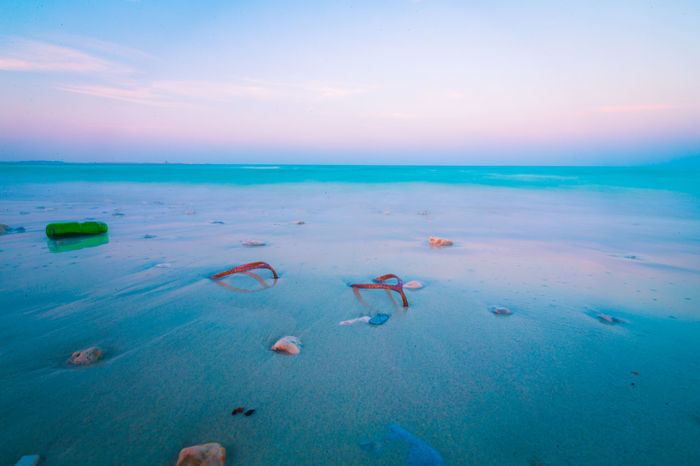 Beach Beauty In Nature Blue Cloud - Sky Day Horizon Over Water Idyllic Landscape Nature No People Outdoors Scenics Sea Sky Sunset Tranquil Scene Travel Destinations Water
