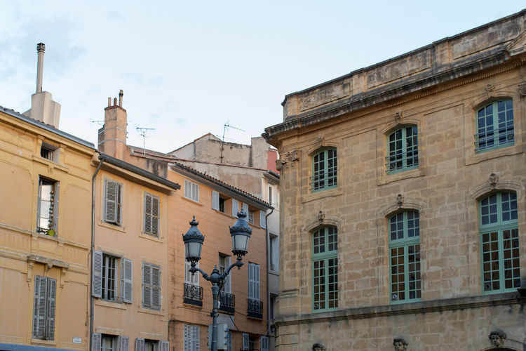 Building exterior at Aix-en Provance Architecture Building Building Exterior Built Structure City City Life Cloud - Sky Day Development High Section Historic Low Angle View No People Old City Outdoors Sky Window