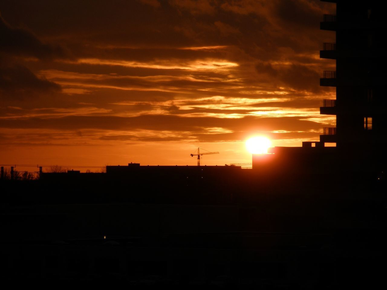 sunset, sky, cloud - sky, orange color, silhouette, architecture, built structure, sun, beauty in nature, scenics - nature, no people, building exterior, nature, sunlight, idyllic, outdoors, city, tranquility, tranquil scene, dramatic sky, dark