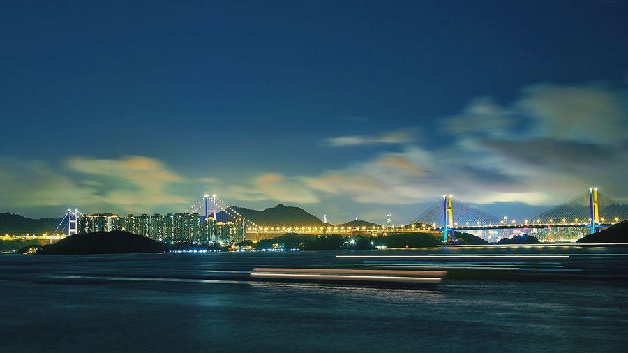 Illuminated Bridge Over River By Tsuen Wan Against Sky