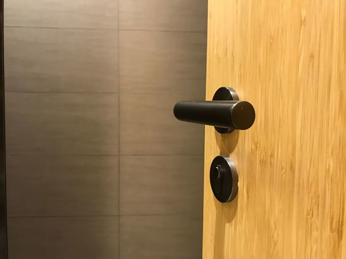 Entrance Door Wood - Material Knob Doorknob Handle No People Wall - Building Feature Copy Space Modern Safety Security Protection Luxury Apartment Indoors  Built Structure Close-up Architecture Pattern
