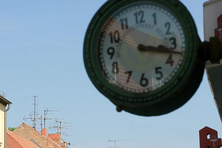 Low angle view of clock against clear sky